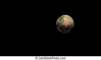 Evil Moon With Passing Clouds - Moon with ominous red glow...