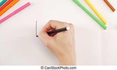 Woman drawing the coordinate system using black felt-tip pen...