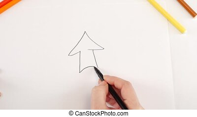 Woman drawing the arrow using different felt-tip pen on white paper, time lapse