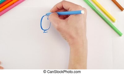 Woman drawing the balloons using different felt-tip pen on...