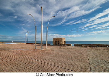 Torrevieja beach promenade - Old watchtower and promenade on...