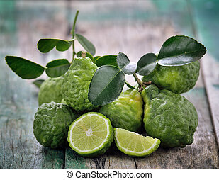 bergamot on wooden table background