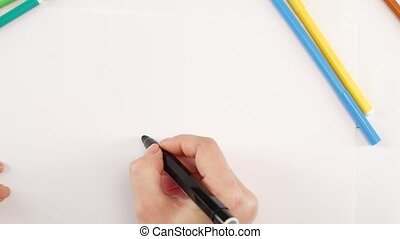 Woman drawing the ellipsis using black felt-tip pen on white...