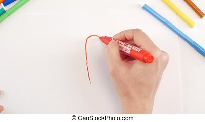 Woman drawing the exclamation point using red felt-tip pen...