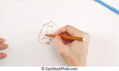 Woman drawing the jacket using brown felt-tip pen on white...