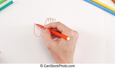 Woman drawing the flowers using different felt-tip pen on...