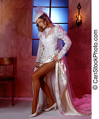 Naughty Bride - Bride in white gown showing some leg