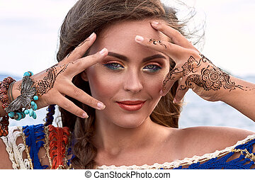 Beautiful girl, bright clothes, accessories, makeup mehendi,...