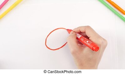 Woman drawing the ladybug using red felt-tip pen on white...