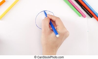 Woman drawing world using different felt-tip pen on white...