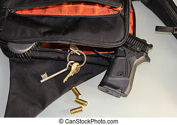 Carried concealed. Handgun and accessories falling from a...