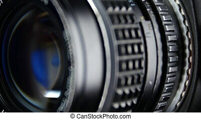 Camera diaphragm opening, close up, cam moves to the right -...