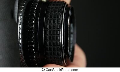Wheel on camera aperture, change focus, close up - Wheel...