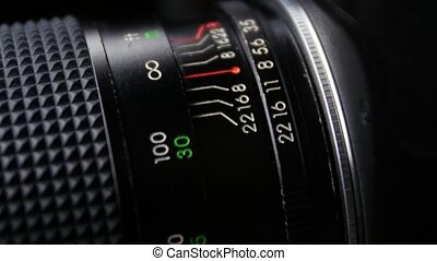 Wheel on camera aperture, change focus, up view, close up -...