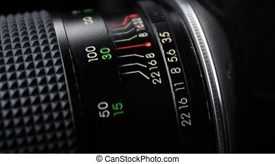 Wheel on camera aperture, distance, up view, close up -...