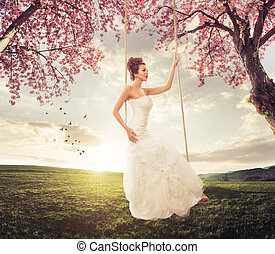 Beautiful Bride swing in the spring