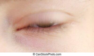 Human eye blinks, close up, slow motion - Brown human eye...