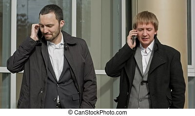 Business people calling by mobile phone. Happy and smiling