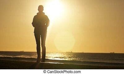Outdoors fitness runner woman running in park exercising at sunrise / sunset
