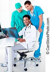 Medical team looking at a radiograp