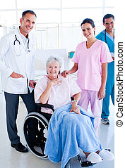Medical team with a senior patient