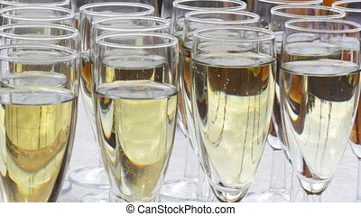 Glasses of sparkling champagne on a buffet table