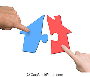 Woman man two hands assembling different colorful house shape puzzles