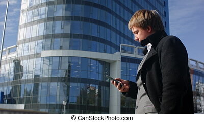 Successful businessman is reading a message on his smartphone