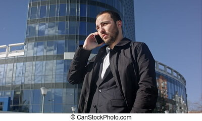 Businessman calling on mobile phone Professional shot on...