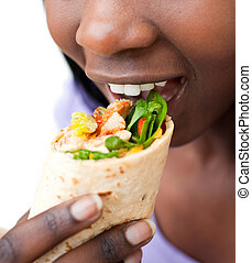 Afro-woman eating a wrap
