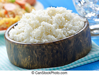 rice in the wood bowl on table