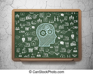 Business concept: Head With Gears on School Board background
