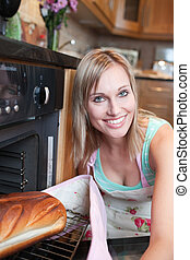 Radiant woman baking bread