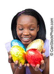 Cheerful woman holding colorful Easter eggs isolated on a...