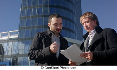 Businessman tear blank paper on meeting outdoor....