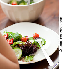 Close-up of a woman eating a salad