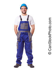 Full length portrait of a manual worker with blue helmet and uniform