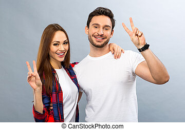 Joyful young couple expressing positivity - Life is great....