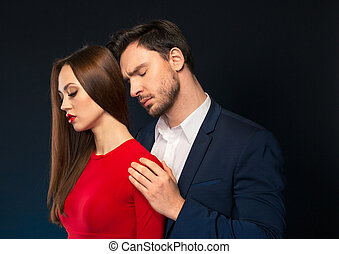 Handsome man embracing attractive woman - In whirlwind of...