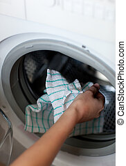 Close-up of a woman doing laundry