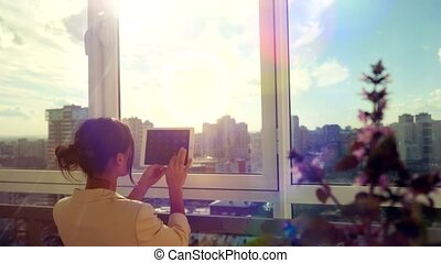 businesswoman use tablet with sunbeam Business girl young...