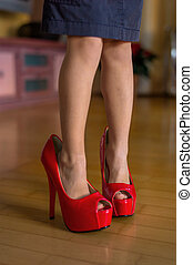 child with big shoes - a kind tasted the big shoes of an...