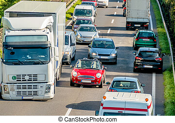 cars and trucks stuck in traffic, symbol of commuter...