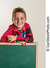 schoolboy with school board - a child with a blank...