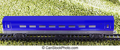 Blue wagon of toy train, horizontal image
