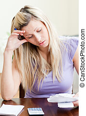 Frustrated woman paying her bills