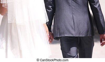 the newlyweds holding hands - the couple holding hands from...