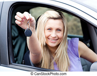 Enthusiastic young driver holding a key after bying a new...
