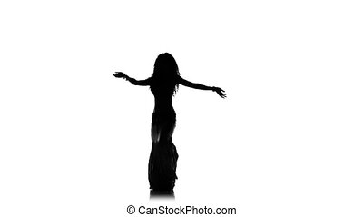 Beautiful exotic belly dancer girl shaking her hips, on white, slow motion, silhouette
