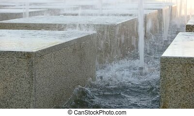 Modern fountain with granite cubes